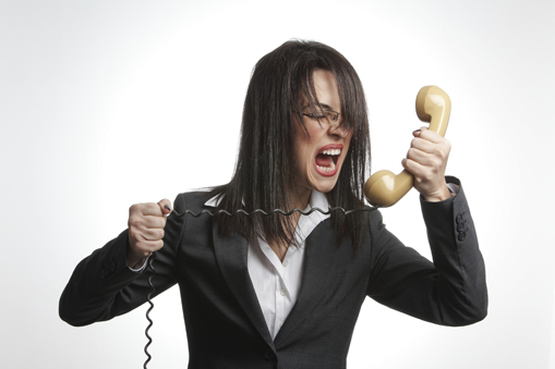 Angry Woman shouting into telephone